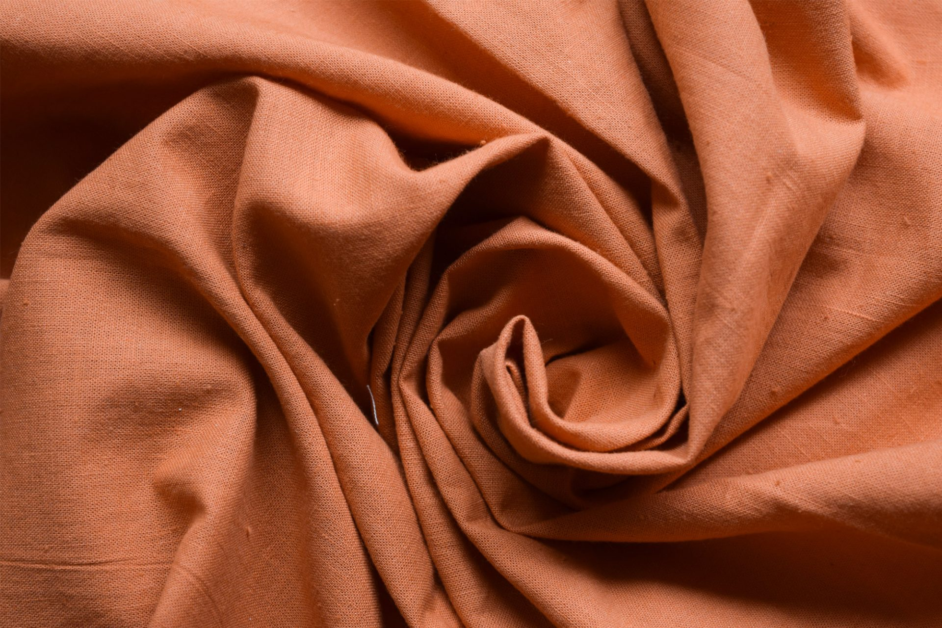Orange cotton khadi fabric.